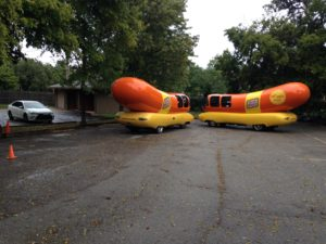Oscar Meyer hotdog marketing vehicles parked behind the inn.